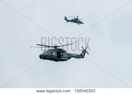 BERLIN GERMANY - JUNE 01 2016: Helicopter NH90 (foreground) and Eurocopter Tiger (background) of the German Army. Demonstrative performance. Exhibition ILA Berlin Air Show 2016