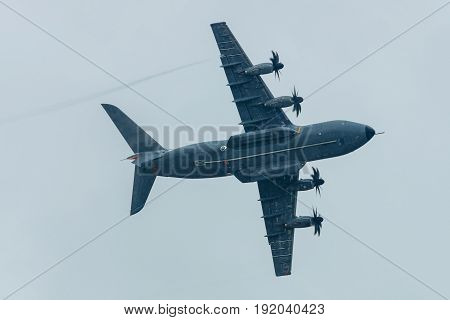 BERLIN GERMANY - JUNE 01 2016: Demonstration flight at rainy day of the military transport aircraft Airbus A400M Atlas. Exhibition ILA Berlin Air Show 2016