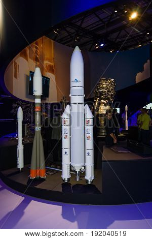 BERLIN GERMANY - JUNE 01 2016: The stand of the European Space Agency. Models launch vehicles Ariane and Soyuz. Exhibition ILA Berlin Air Show 2016