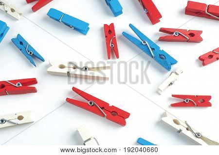 Red, blue, white cloth pin on white background
