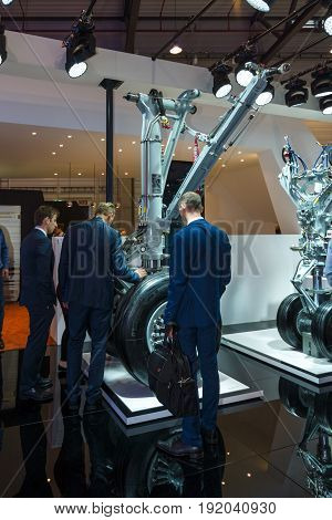 BERLIN GERMANY - JUNE 01 2016: The stand of engineering company Liebherr. Front landing gear of airliners. Exhibition ILA Berlin Air Show 2016.