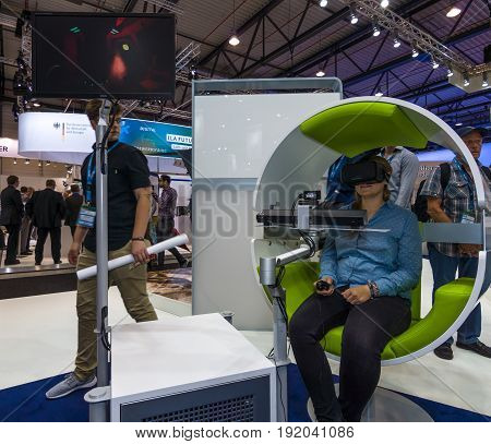 BERLIN GERMANY - JUNE 01 2016: The stand of Airbus Group. Flight simulator based on virtual reality glasses Oculus Rift. Exhibition ILA Berlin Air Show 2016.