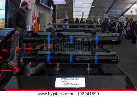 BERLIN GERMANY - JUNE 01 2016: The stand of Roketsan is a major Turkish weapons manufacturer and defense. In the foreground Mizrak-U is a long range air-to-surface anti-tank missile. Exhibition ILA Berlin Air Show 2016.