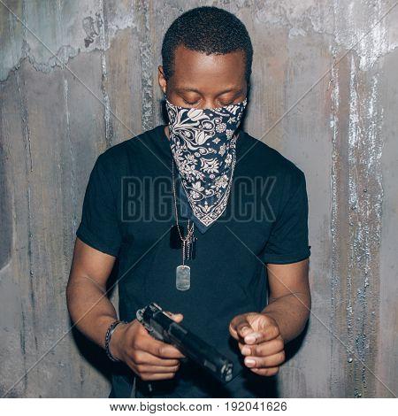 Black mercenary mercenary with gun.