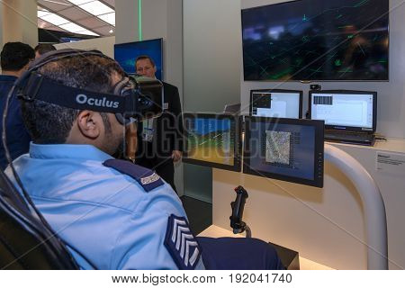 BERLIN GERMANY - JUNE 01 2016: The stand of the company Airbus Defense & Space. A military in glasses Oculus Rift at the console flight simulator Sferion. Exhibition ILA Berlin Air Show 2016.