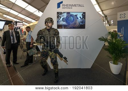 BERLIN GERMANY - JUNE 01 2016: The stand of Rheinmetall Defence. Modern equipment a soldier of the German army (Bundeswehr). Exhibition ILA Berlin Air Show 2016.