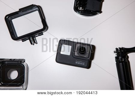 Kharkov, Ukraine - April 13, 2017: GoPro HERO 5 action camera with accessories on white background. Compact gadget waterproof, support 4k video, voice controls and is often used in extreme photography