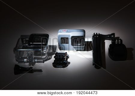 Kharkov, Ukraine - April 13, 2017: GoPro HERO 5 action camera with accessories in spotlight on white background. Compact gadget waterproof, support 4k video and is often used in extreme photography