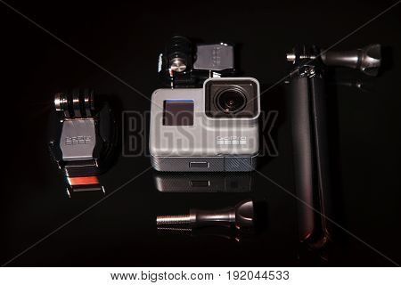 Kharkov, Ukraine - April 13, 2017: GoPro HERO 5 action camera with tripod on black background. Compact gadget waterproof, support 4k video, voice controls and is often used in extreme photography