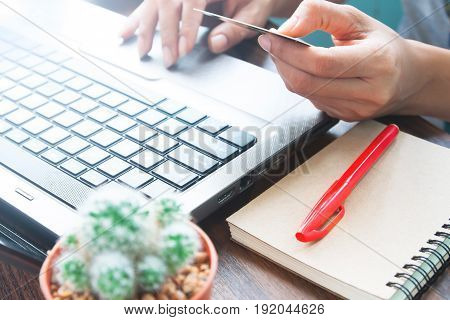 Business and shopping on line with credit card Woman hands using laptop and credit card