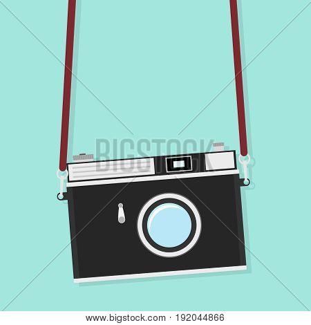 Old camera on the strap. Retro camera. Flat design vector illustration vector.