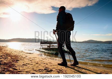 Tourist With Backpack Walk At Pedal Boat. Autumn Sunny Day On Beach