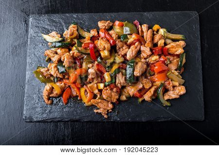 Beef Fajitas With Colorful Bell Peppers In Slate Plate.  Top View.