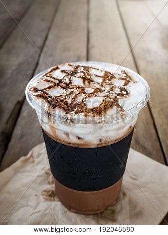 Ice Coffee Topped With Whip Cream And Cocoa