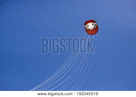 FANOE DENMARK JUNE 17 2017: Japanese kite on a blue cloudless sky high up over the beach on Fanoe. Fanoe Kite Fliers Meeting June 2017.
