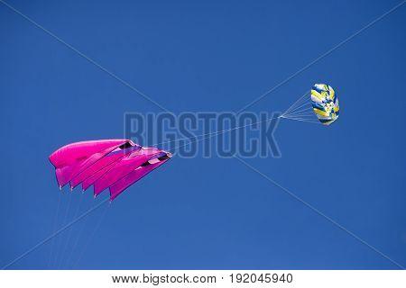 FANOE DENMARK JUNE 17 2017: Colorful kite high up on a blue cloudless sky over the beach on Fanoe. Fanoe Kite Fliers Meeting June 2017.