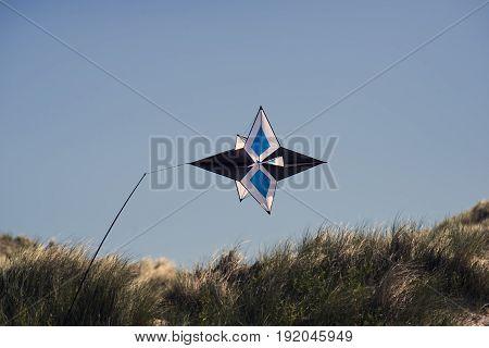 FANOE DENMARK JUNE 17 2017: Kite sky blue in the dunes close to the beach on Fanoe. Fanoe Kite Fliers Meeting June 2017.