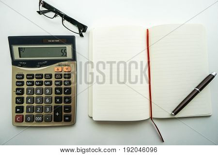 accountant eyeglasses on office desk during working on budget calculation