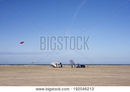 FANOE DENMARK JUNE 17 2017: Early start of the kite festival on the big beach with the North Sea in the background on Fanoe beach. Fanoe Kite Fliers Meeting June 2017.