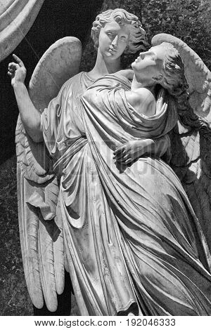 Marble statue of angelic couple in Florence, Italy. Black and white image