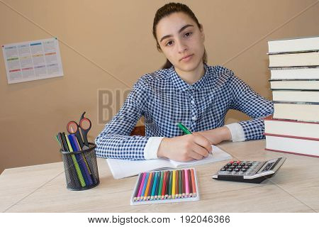 Young student woman with lots of books studying for exams. Education concept