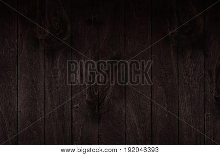 Dark brown vintage wooden board background. Wood texture.