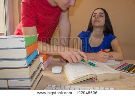 Older brother Helping Student sister Working At Desk. Human emotion facial expression reaction feelings education concept