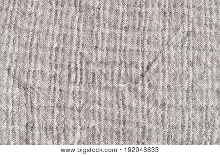 Gray canvas rough crumpled fabric texture. Abstract background.