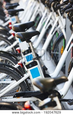 Eco-friendly urban transport. Electric bikes charging batteries. Environmental protection