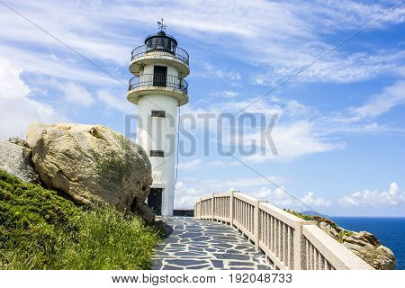 The lighthouse at Punta Roncadoira in Xove Galicia Spain.