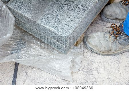 Above view on wooden pallet with paving slabs at building site ready for use.