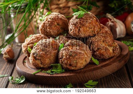 Stack Of Baked Meatballs On A Chopping Board