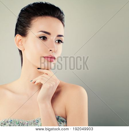Cute Young Model Woman on Background with Copyspace