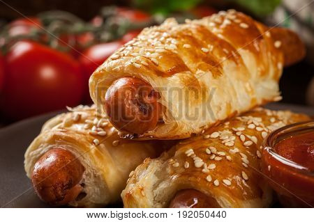 Rolled Hot Dog Sausages Baked In Puff Pastry