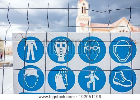 Safety list of behavior rules on a construction site. Building site safety rules are on the poster fastened to the fence. poster