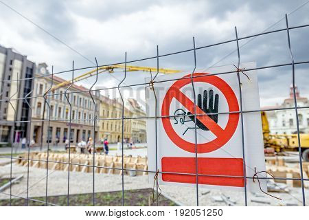 Safety list of behavior rules on a construction site. Building site safety rules are on the poster fastened to the fence.