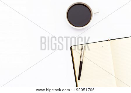 Pen On The Open Day Planner And A Cup Of Black Coffee On A White Background. Minimal Business The Co