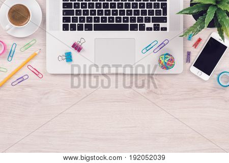 Office desk. Workplace. Laptop and smartphone. Copy space. Mockup. Top view flat lay.