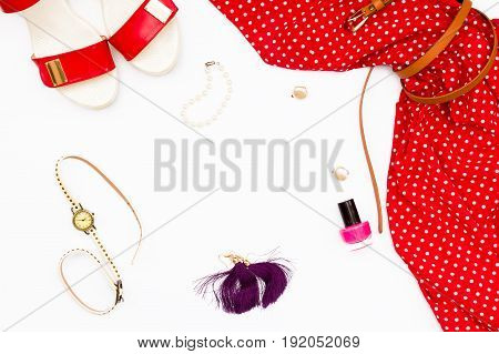 Red Dress, Shoes, Watches, Nail Polish And Earrings On A White Background. Feminine Concept Beauty.