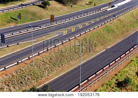 Morning landscape close up of empty M41 freeway with on and off ramps passing through Mhlanga ridge in Durban South Africa