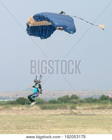 Male Skydiver Coming In For Fast Landing On Grass (landing Series Image 2 Of 4).