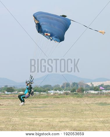 Male Skydiver Coming In For Fast Landing On Grass (landing Series Image 3 Of 4).