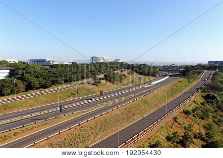 Quiet morning landscape of M41 freeway passing through Mhlanga ridge against blue sky in Durban South Africa