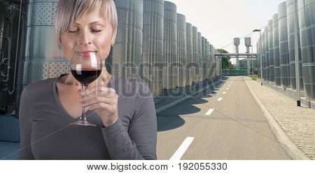 Outdoors portrait of a beautiful wine tasting tourist woman