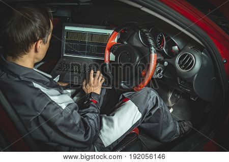 car diagnostic: the electronics in the red car running with oscillographs