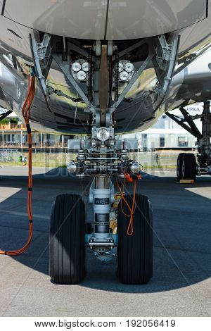 BERLIN GERMANY - JUNE 02 2016: Front landing gear of the newest airplane Airbus A350-900 XWB. Exhibition ILA Berlin Air Show 2016