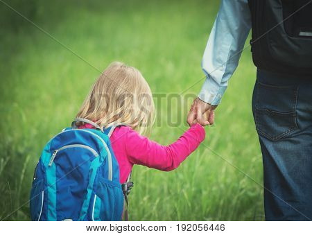 father taking little daughter to school or daycare