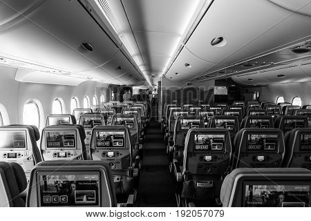 BERLIN GERMANY - JUNE 02 2016: Interior of an economy class of the world's largest aircraft Airbus A380. Emirates Airline. Black and white. Exhibition ILA Berlin Air Show 2016