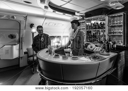 BERLIN GERMANY - JUNE 02 2016: The bar for the passengers the first and business class of the world's largest aircraft Airbus A380. Emirates Airline. Black and white. Exhibition ILA Berlin Air Show 2016