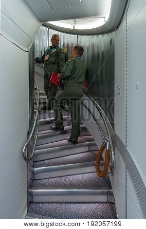 BERLIN GERMANY - JUNE 02 2016: Gangway between the first and second floors of the largest aircraft of the world Airbus A380. Emirates Airline. Exhibition ILA Berlin Air Show 2016